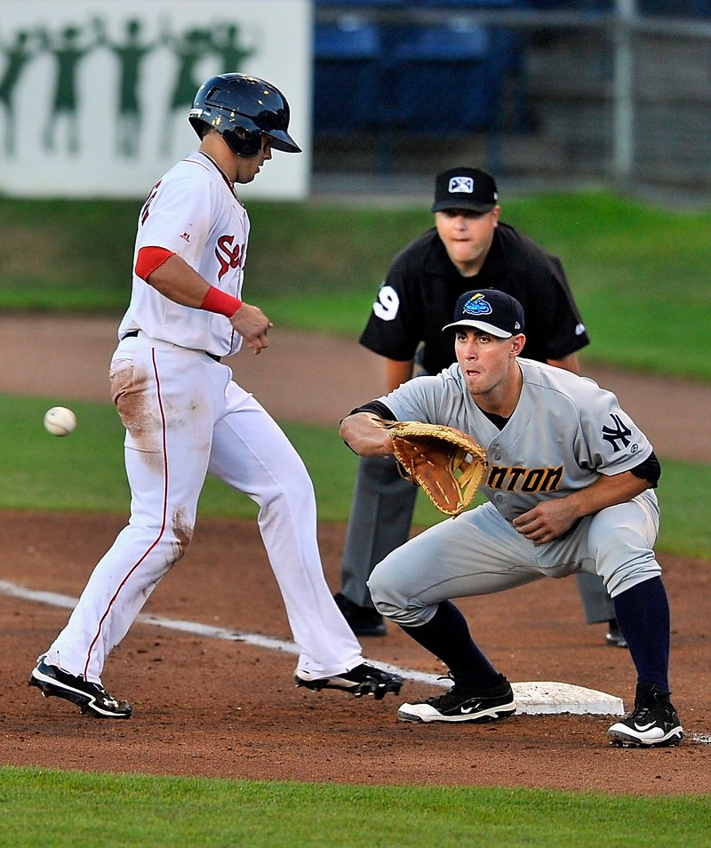 Shannon Wilkerson of the Portland Sea Dogs gets back to first base in time Wednesday night as Andrew Clark of the Trenton Thunder takes the pickoff throw during the Sea Dogs' 7-0 victory at Hadlock Field.