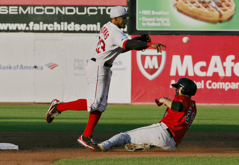 Tony Thomas of the Portland Sea Dogs throws to first in an unsuccessful attempt for a double play Thursday night after forcing Josmil Pinto of New Britain at second base.