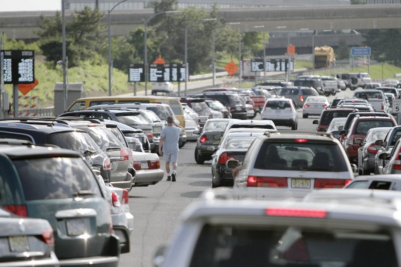 Cars make their way through the cellphone lot at Philadelphia International Airport on June 19. The free parking areas, where people picking up travelers can wait, have sprung up at airports around the country.