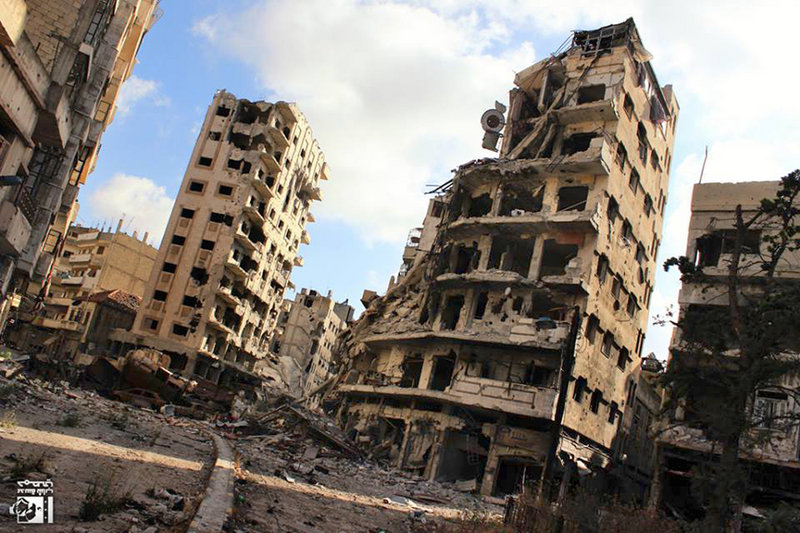 Buildings in the Jouret al-Chiyah neighborhood of Homs, Syria, show damage from government airstrikes and shelling Wednesday. Residents described one of the worst barrages yet on the city of 1 million Friday, which killed a mother and her three children. The U.N. warned of a humanitarian catastrophe with thousands of trapped civilians.