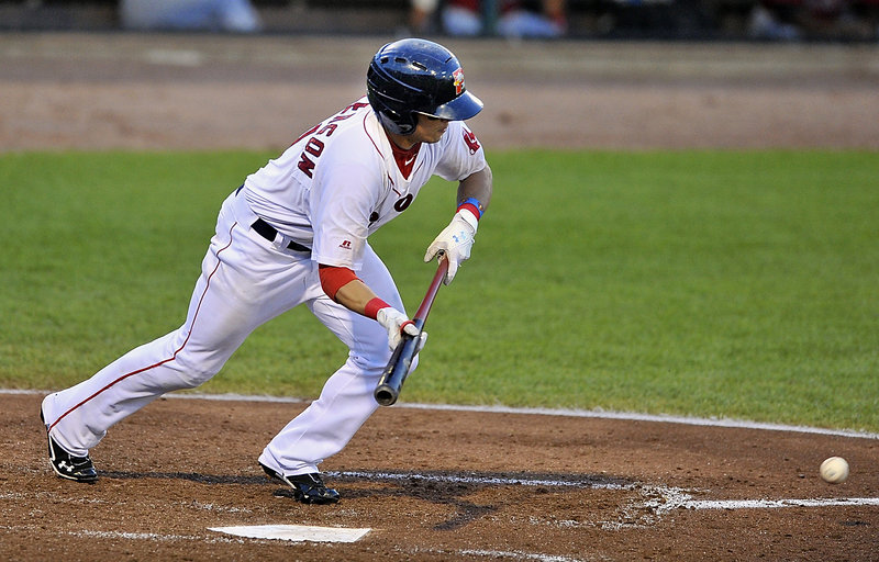 Shannon Wilkerson of the Portland Sea Dogs puts down a bunt Friday night, advancing a runner to third base in the fifth inning of a 7-5 loss to the New Britain Rock Cats at Hadlock Field.