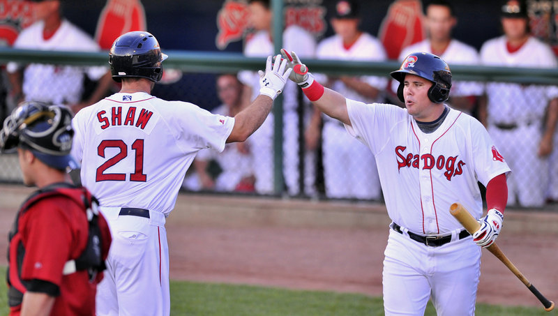 Travis Shaw receives a high-five from J.C. Linares after hitting a solo homer in the second inning. It was the 10th home run of the season for Shaw.