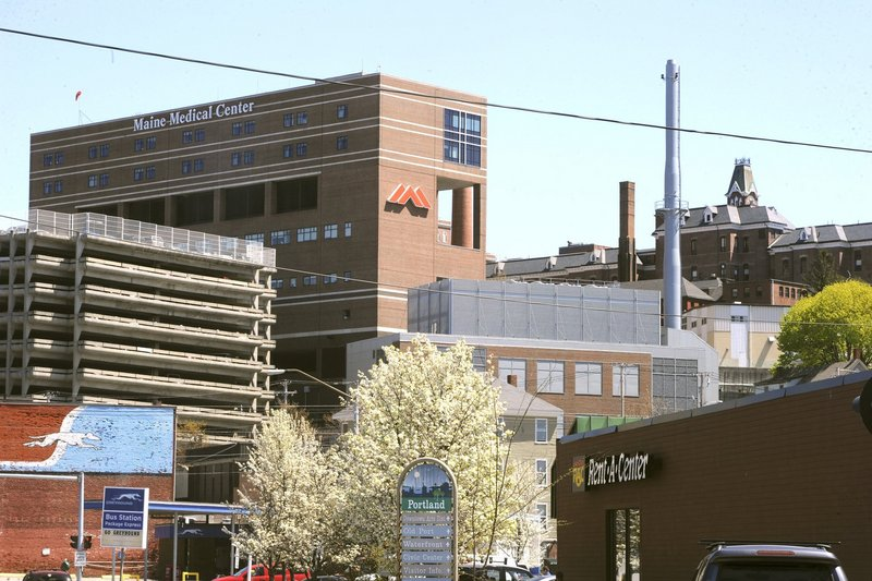 Maine Medical Center in Portland, which announced a hiring freeze in the spring, began offering voluntary retirement buyouts to 400 employees about two weeks ago, citing a $13.4 million operating loss in the first half of its fiscal year.
