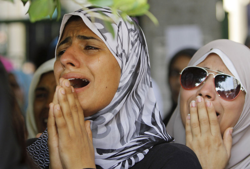 Women grieve during the funeral Saturday of opponents of Egypt's ousted president Mohammed Morsi. They were killed during clashes with Morsi supporters in Cairo.
