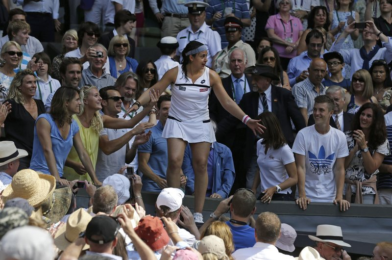 Marion Bartoli of France was in a place she dreamed she'd be someday, among the crowd, exuberant as the Wimbledon women's champion. She never lost a set in the two-week event, and dispatched Sabine Lisicki of Germany in an error-strewn final, 6-1, 6-4.