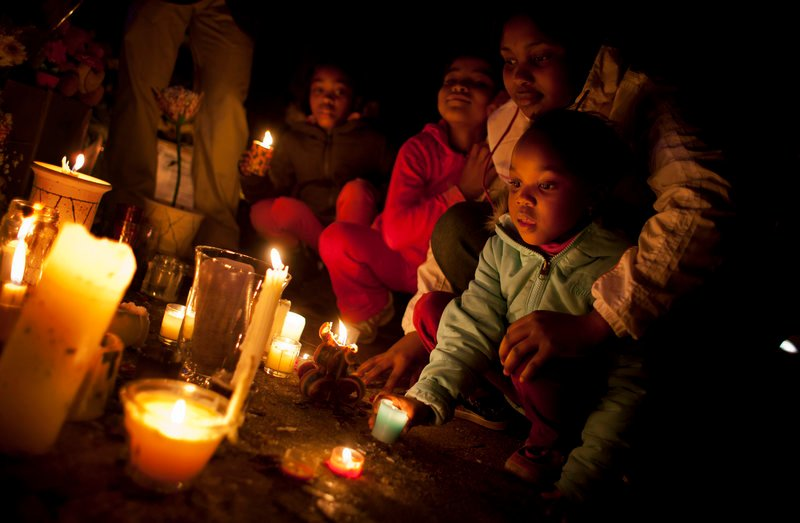 Children light candles for Nelson Mandela on Sunday at the Mediclinic Heart Hospital where the former South African president is being treated in Pretoria, South Africa.