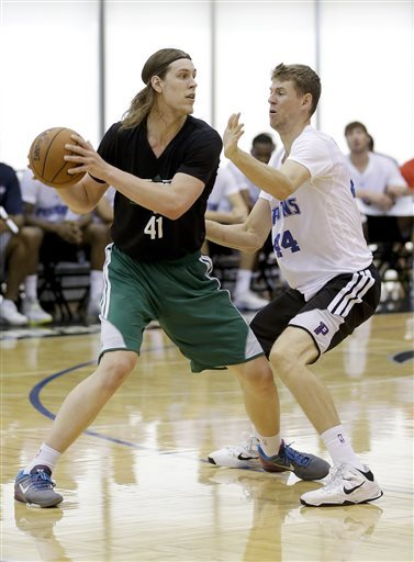 Kelly Olynyk fronts up with Detroit's Travis Peterson in an NBA summer league game at Orlando, Fla., on Monday. The Gonzaga product is earning praise, but tends to be too unselfish at times.