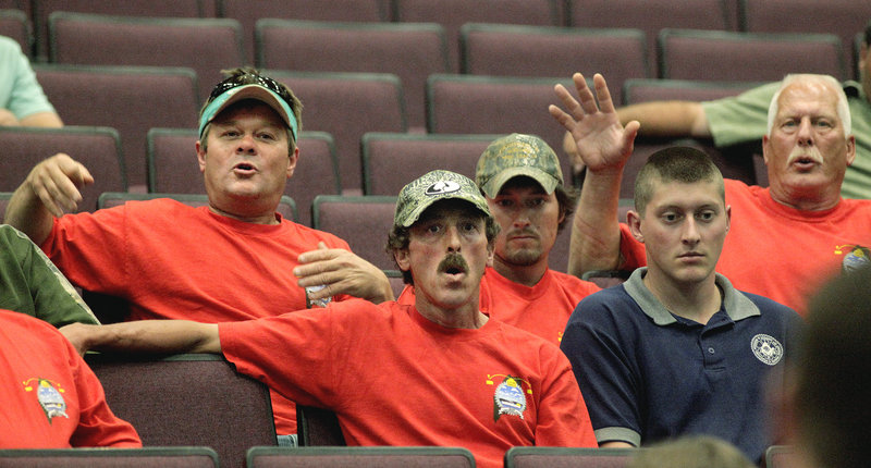 Maine lobstermen react to a point made by Marine Resources Commissioner Patrick Keliher during a meeting Tuesday at Oceanside High School in Rockland.