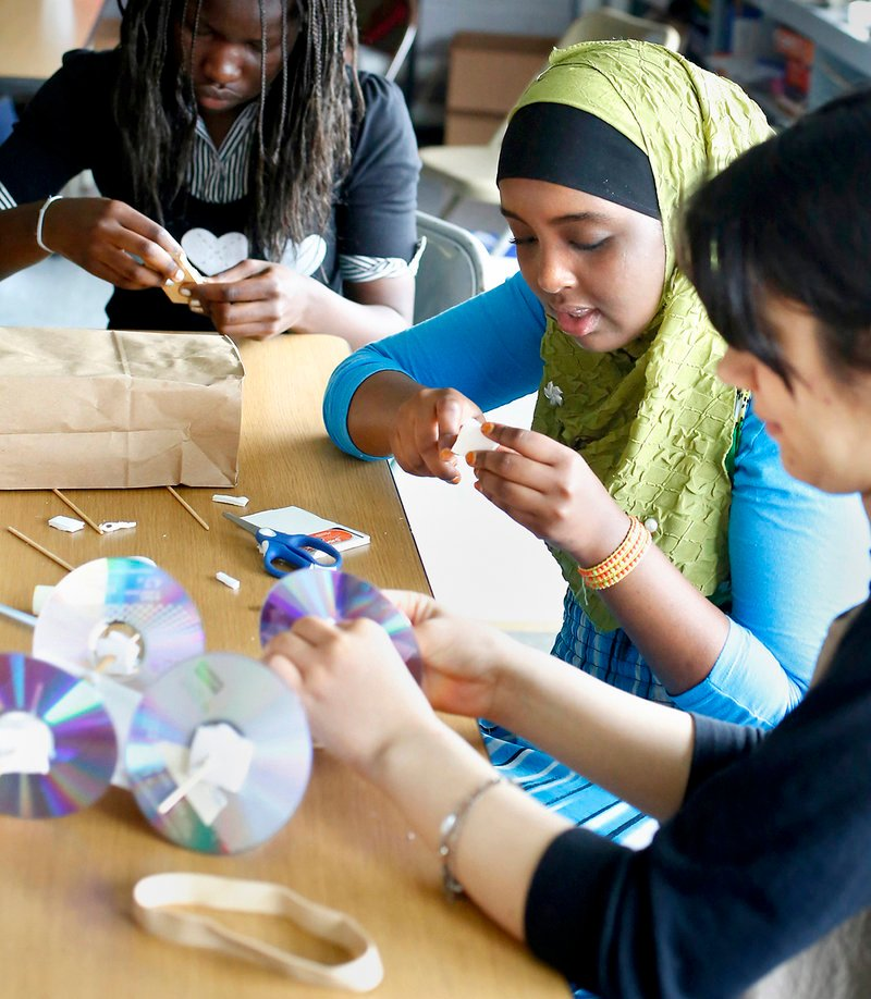 "Lona Peter, 15, from Casco Bay High School, upper left, Sahra Ahmed, 14, Deering High School, middle, and Nilab Nasrat, 19, from Portland High School, build a mousetrap car at the Real School on Mackworth Island in Falmouth on July 10, 2013. A group of 16 girls are wrapping up a free, three-week STEM (science, technology, engineering, math) program, working with local companies to solve ""real world"" problems."