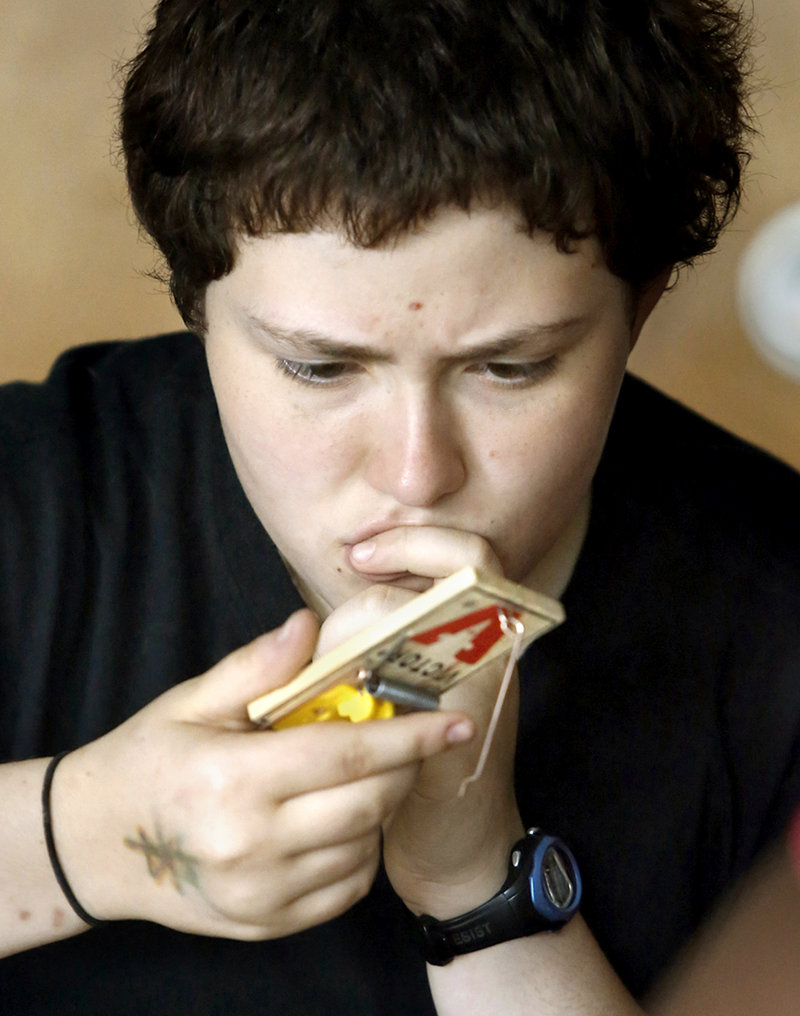 Caitlyn Harrison, 16, from Windham High School, tries to figure out how turn a mousetrap into an engine while building a mousetrap car at the Real School on Mackworth Island in Falmouth on July 10, 2013.