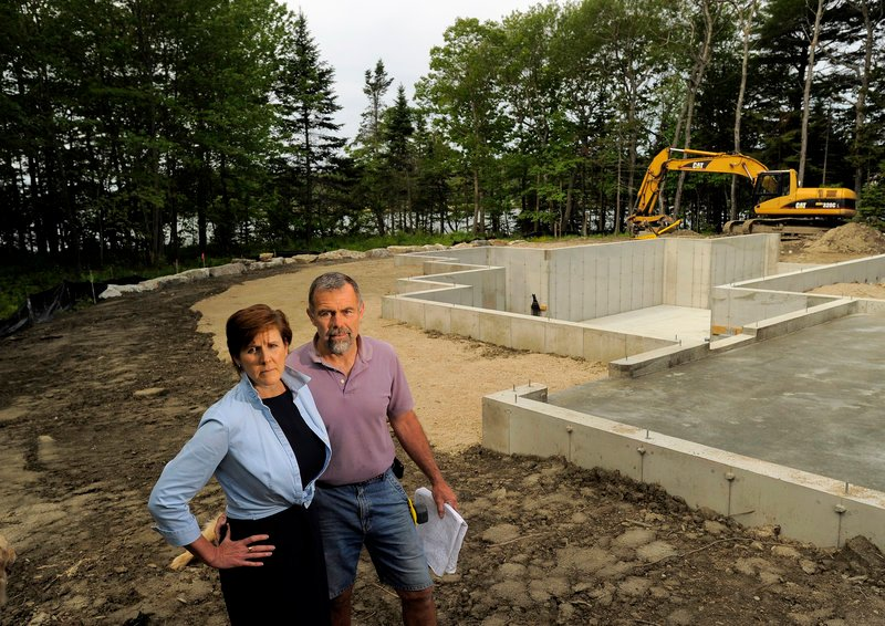 Linda Varrell and her husband, Paul Cormier, say it was difficult and expensive to find insurance for their home being built on Littlejohn Island in Yarmouth. Coastal storms have led to soaring premiums and deductibles for houses on the water's edge.