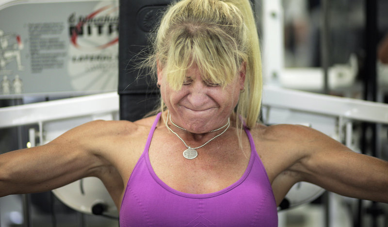 "Aimee Leclerc uses a weight machine that simulates a rowing motion during her workout. Using her slender legs, she can power through a set of eight repetitions of 230 pounds. ""I don't even look at the weight,"" she said."