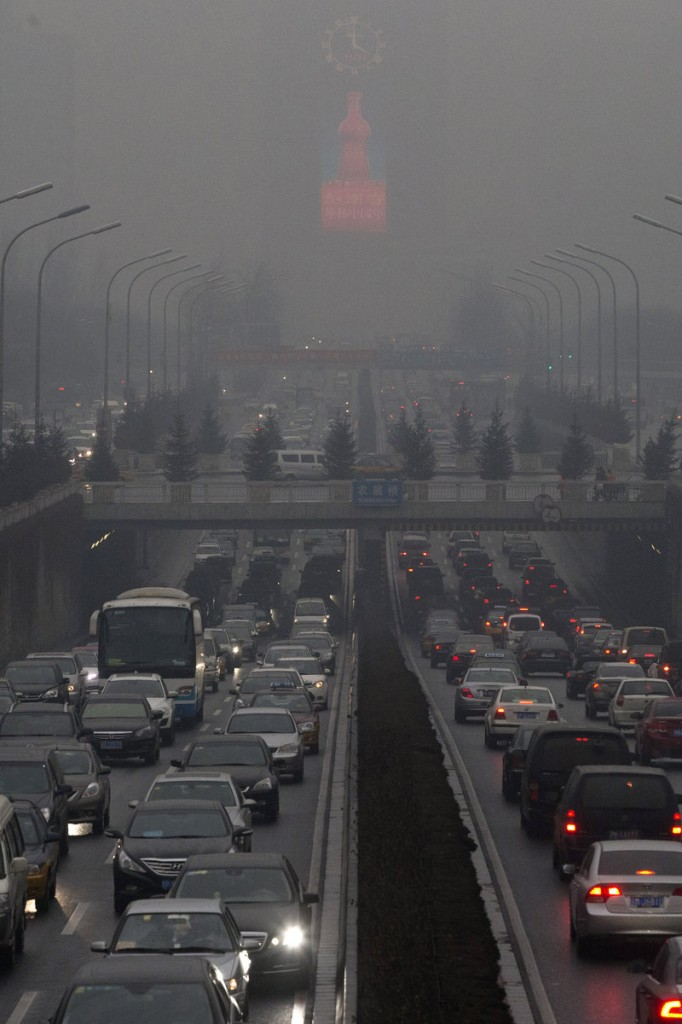 Traffic during a day of heavy pollution in Beijing, China, in January 2014.