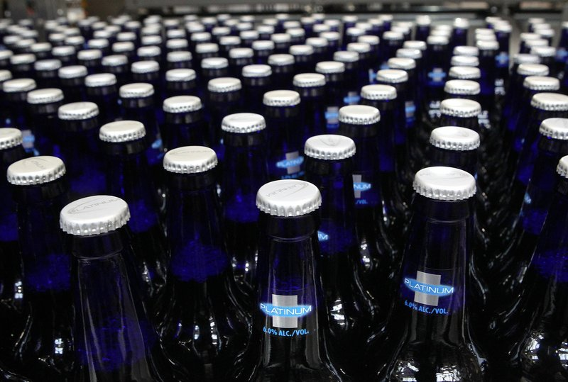 Bottles of Bud Light Platinum move along during the packaging process.