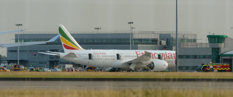 An Air Ethiopian 787 Dreamliner sits at Heathrow Airport in London on Friday after a fire started on board the empty aircraft. Boeing, maker of the 787, saw its stock dive largely on investors' concerns about the plane's lithium-ion batteries.