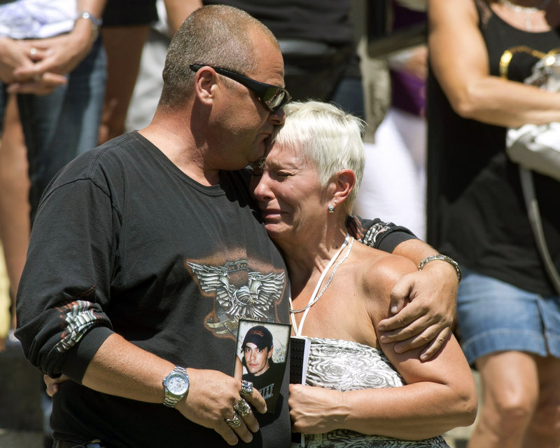 Lise Doyon, right, is comforted by her friend Jeannot Labrecque, as church bells chime 50 times Saturday in the Canadian town of Lac-Megantic for the victims of the train explosion July 6. Doyon lost her son Kevin Roy and her daughter-in-law in the accident.