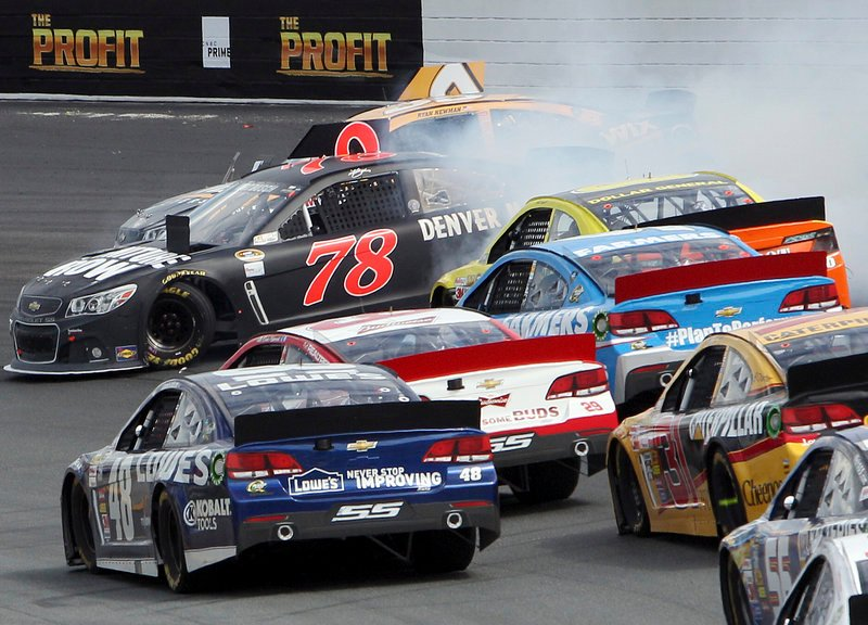 Kurt Busch, 78, and Ryan Newman, behind him, get sideways in Turn 2 of the NASCAR Sprint Cup series race at the New Hampshire Motor Speedway in Loudon, N.H., on Sunday.