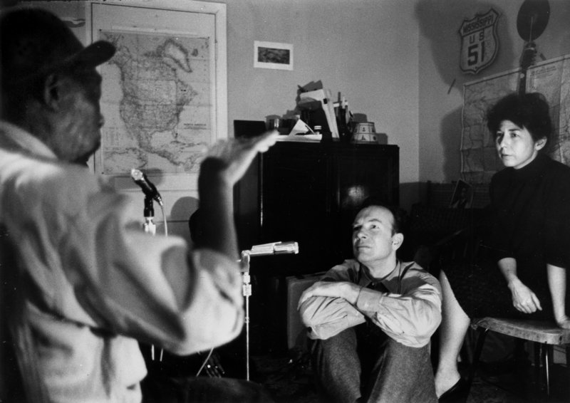 Folk singer Pete Seeger, center, and his wife, Toshi Seeger, sit in on a recording session with Mississippi John Hurt. The headline on Toshi Seeger's obituary overlooked her role as organizer and producer of thousands of events, a reader says.