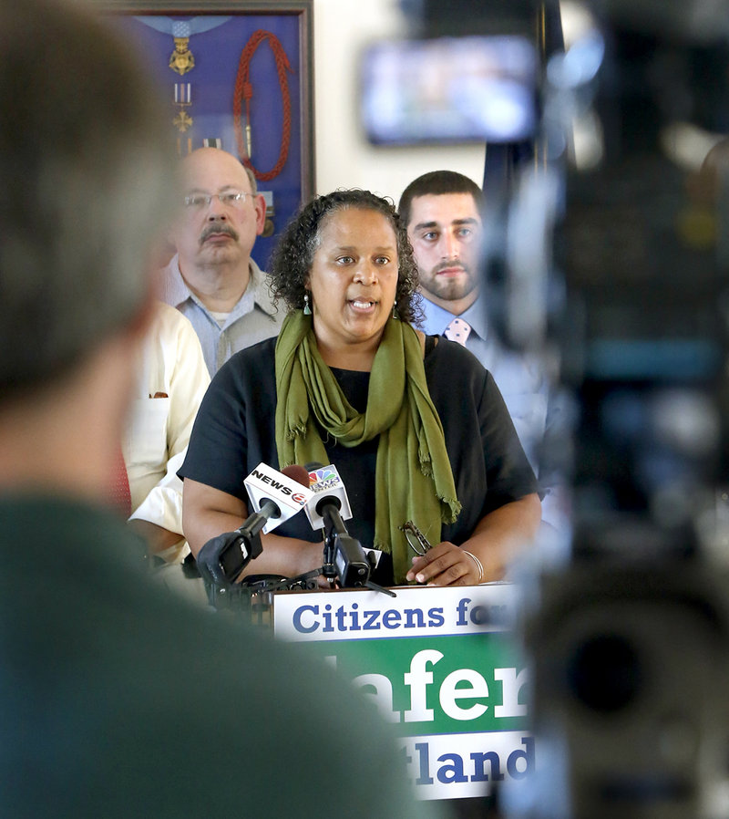 Regina Phillips, a NAACP of Maine board member, speaks during news conference Monday at City Hall to promote making marijuana legal in Portland. Voters will decide the issue Nov. 5 after the City Council rejected an opportunity to legalize it Monday night.