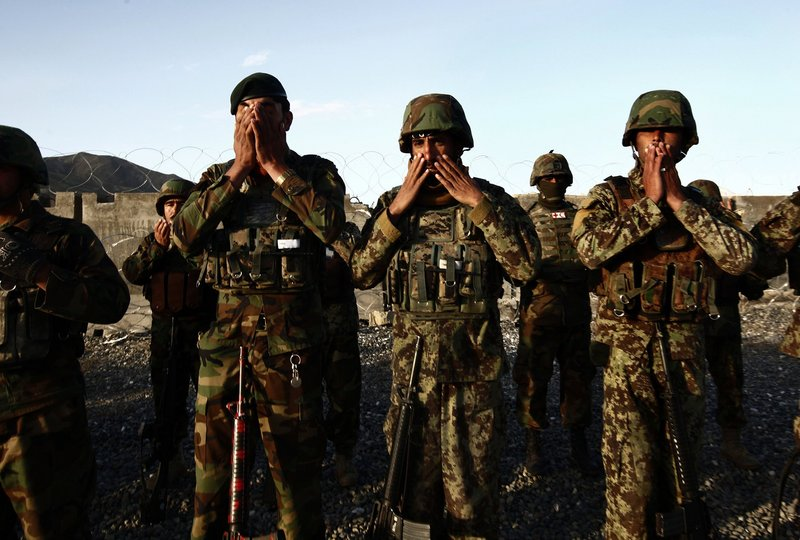 Afghan soldiers pray before a patrol in Maidan Shar. Many military operations lie ahead for the soldiers as they prepare to take on full responsibility for trying to hold the Taliban at bay.