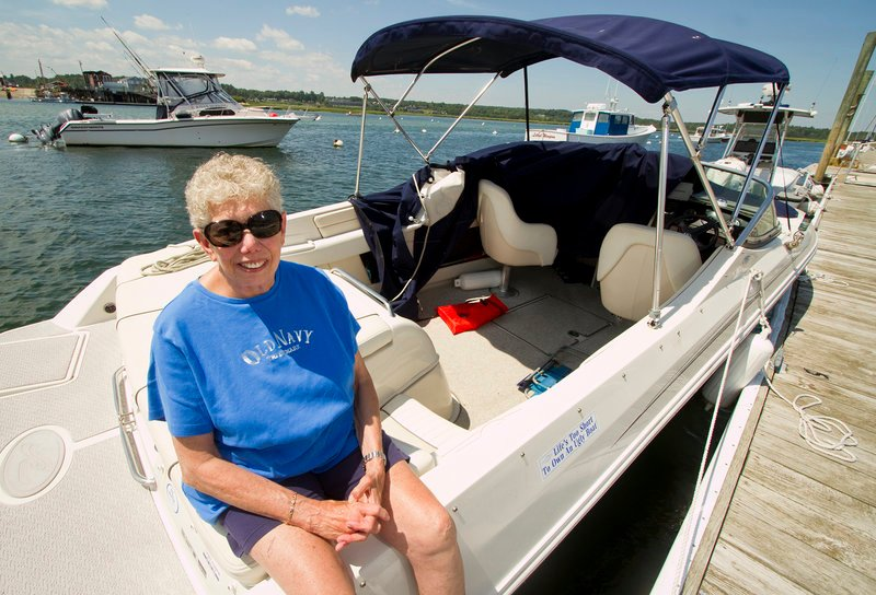 Shirley Polinger of Wells sits on her boat Monday in Wells Harbor, where it was towed after becoming disabled Saturday off the coast. She said when a boater came to her aid,
