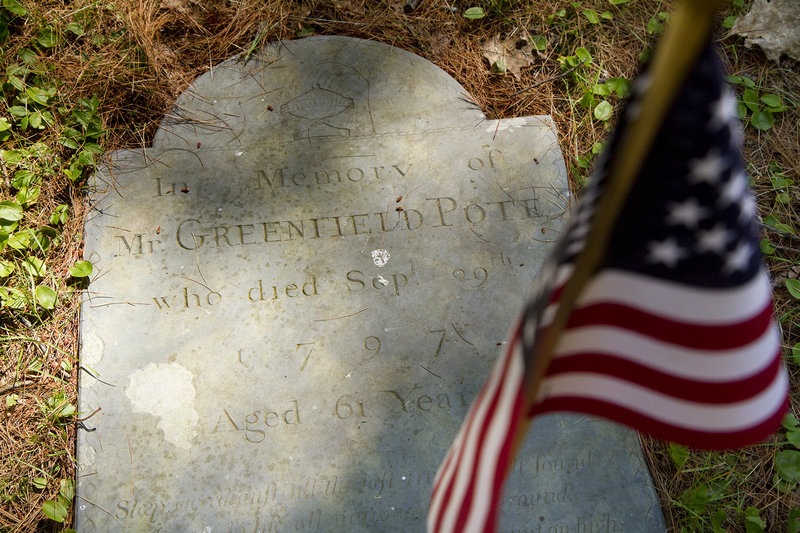 A gravestone of Captain Greenfield Pote is set on the ground of a cemetery near the Captain Greenfield Pote House, the oldest house in Freeport. Photographed on Monday, July 15, 2013.