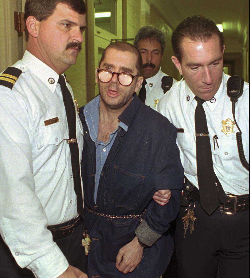 In this April 29, 1996 file photo, Lewis Lent Jr. is led from the Berkshire County Courthouse in Pittsfield, Mass., after a competency hearing was postponed. Massachusetts law enforcement authorities said Monday, July 15, 2013, that Lent, who is serving a life sentence for killing two children, also is responsible for the disappearance and death of James Lusher, 16, who was never seen again after leaving his Westfield, Mass., home on a bicycle ride in 1992. (AP Photo/Alan Solomon)