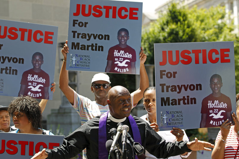 Anthony Evans, president of the National Black Church Initiative, speaks to the media during a demonstration asking for justice for Trayvon Martin, outside the Department of Justice in Washington on Monday. George Zimmerman was acquitted in the shooting death of the unarmed, 17-year-old black teenager.