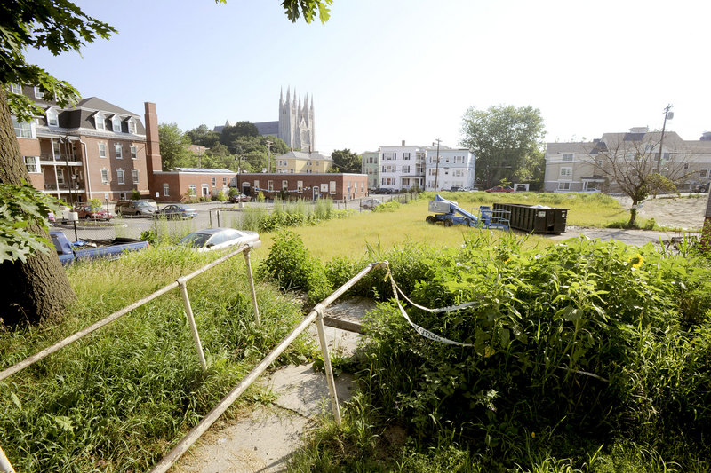This view from Bates Street in Lewiston shows a portion of the now-cleared site of an arson fire that destroyed buildings at 105-111 Blake St., 172 Bates St. and 82 Pine St. on April 29. The city is working with the owner to determine the future of the site.