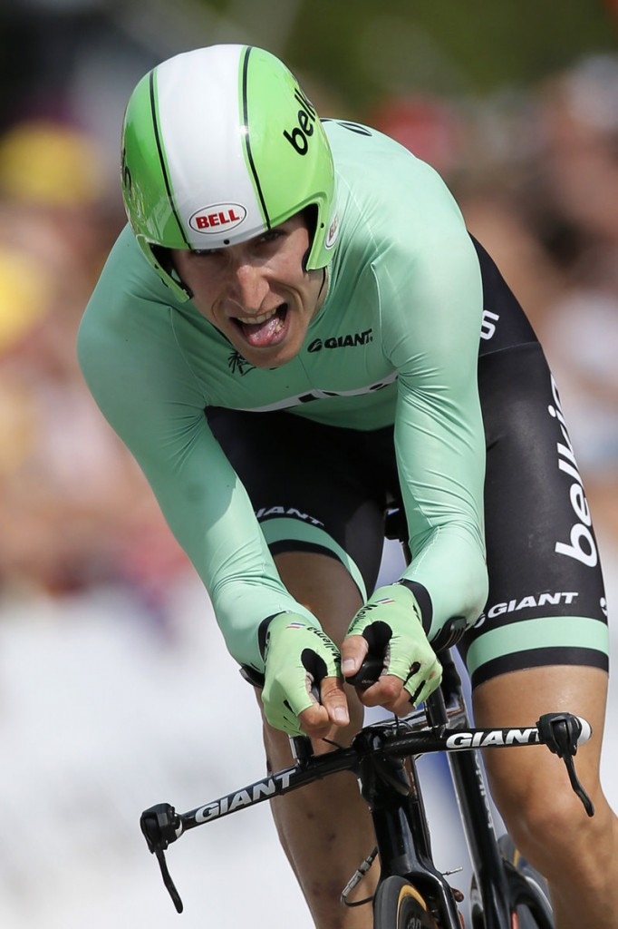 Bauke Mollema of the Netherlands, who tumbled from second to fourth place overall, strains near the end of the 17th stage Wednesday.