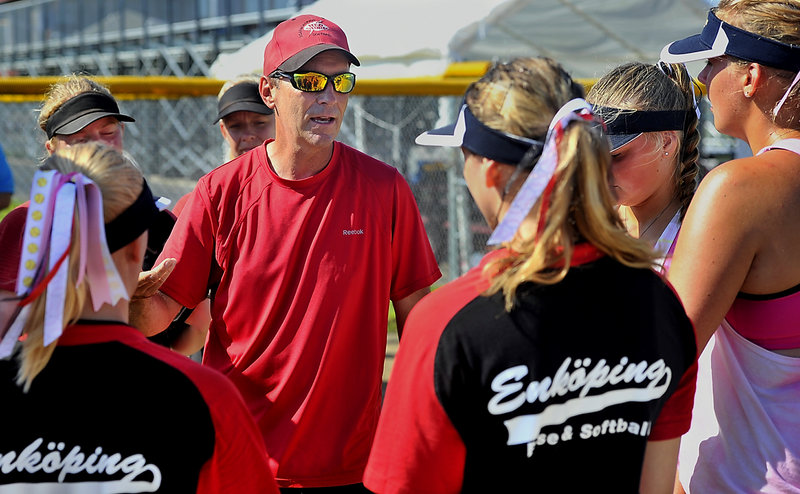 Scarborough Coach Tom Griffin shares his knowledge of softball during a break in practice as a team of Swedish players learn the finer points of the game.