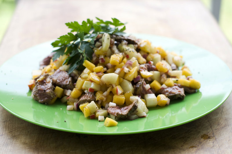 Chili mango-beef salad is made with a child's favorite steak and nice chunks of fruit. Radishes and onions, less beloved by some kids, are finely chopped.
