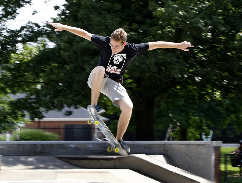 "Joshua Roberts catches some air after leading a recent Skate Church service at the Skate Park in Woodland Park in Lexington, Ky. ""What better way to do church than with a skateboard?"" he said."