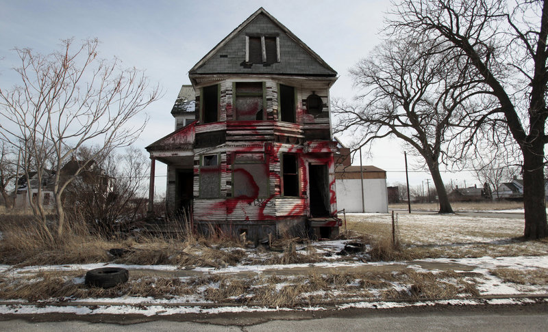 A vacant and blighted home sits alone in an east side neighborhood once full of homes in Detroit on Jan. 27. The story of Detroit's decline is decades old: Its tax revenue and population have shrunk and labor costs have remained high.