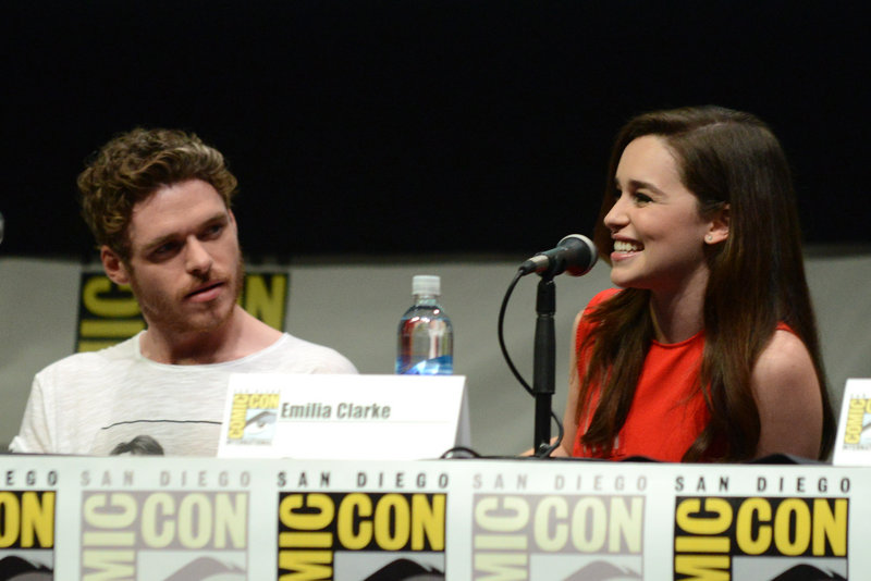Richard Madden, who plays Robb Stark, and Emilia Clarke, who plays Daenerys Targaryen, appear at Comic-Con on Friday in San Diego.