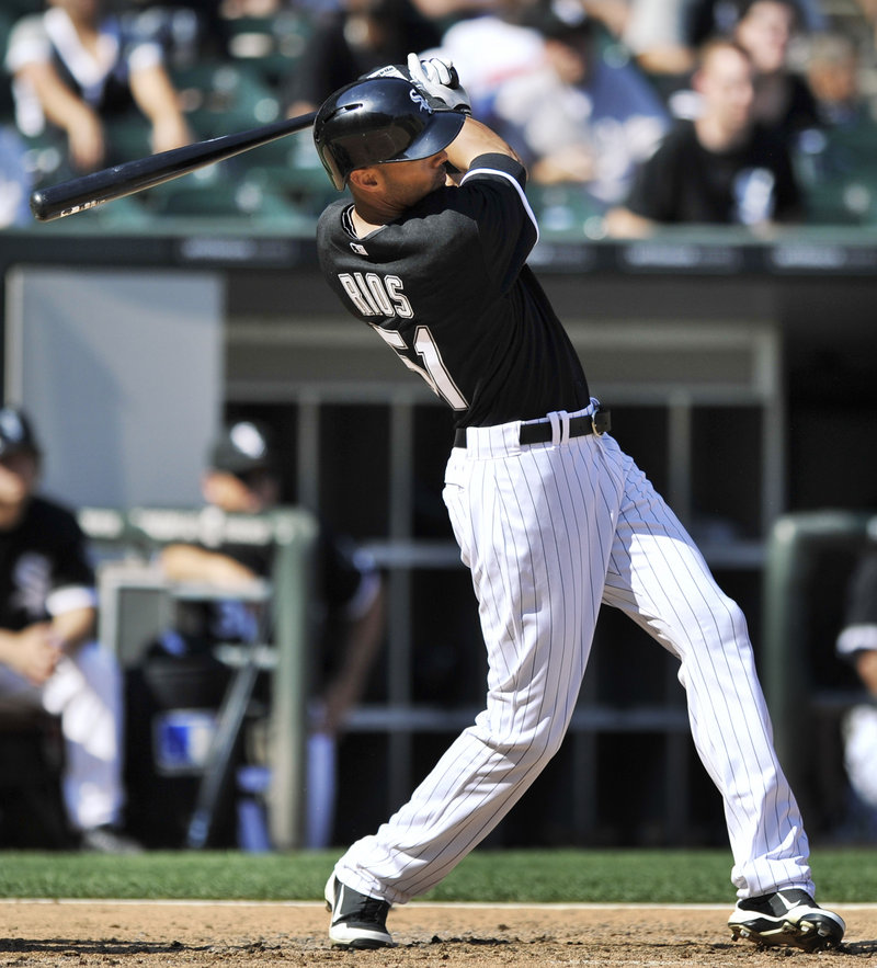 Alex Rios of the host Chicago White Sox connects with a third-inning grand slam in Saturday's 10-6 victory over the Atlanta Braves.