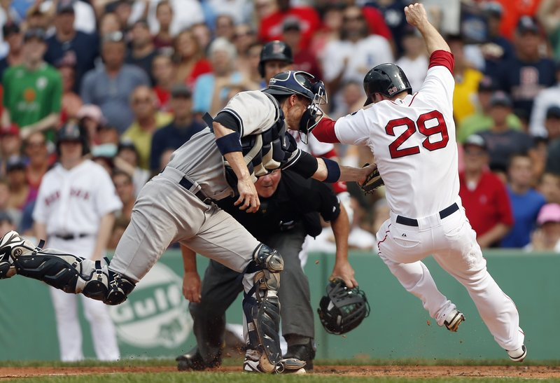 Yankees catcher Chris Stewart extends to put the tag on Boston's Daniel Nava during the first inning of a 5-2 Yankees' win at Fenway Park on Saturday afternoon. The two teams wind up their three-game series Sunday at 8:05 p.m.