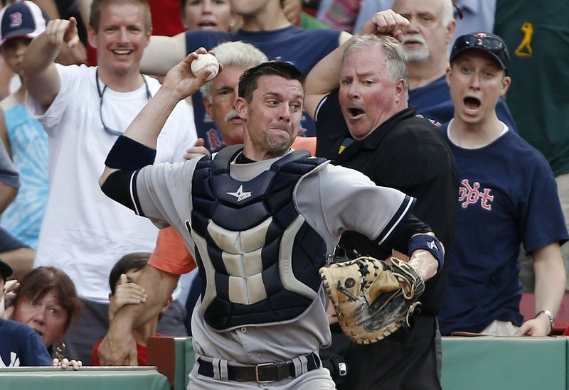 Yankees catcher Chris Stewart, who had just dived into the stands to catch a foul pop, whirls to throw out Boston's Daniel Nava, who was trying to tag and advance to second.