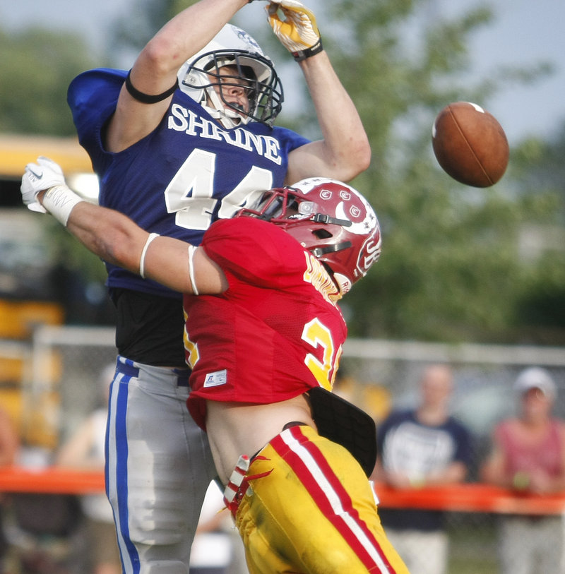 Logan Steward of Hampden Academy breaks up a pass by stopping Nicholas Mills of Telstar. The Lobster Bowl brings together the top graduated seniors in the state.