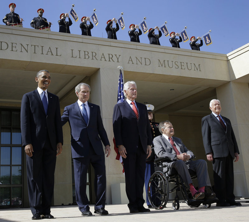 Five American leaders appear together at a dedication ceremony in Dallas on April 25. From left are President Obama and four former presidents, George W. Bush, Bill Clinton, George H.W. Bush and Jimmy Carter.