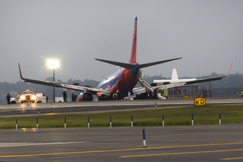 A Southwest Airlines jet rests on the tarmac after its front gear collapsed after landing Monday at LaGuardia Airport in New York.