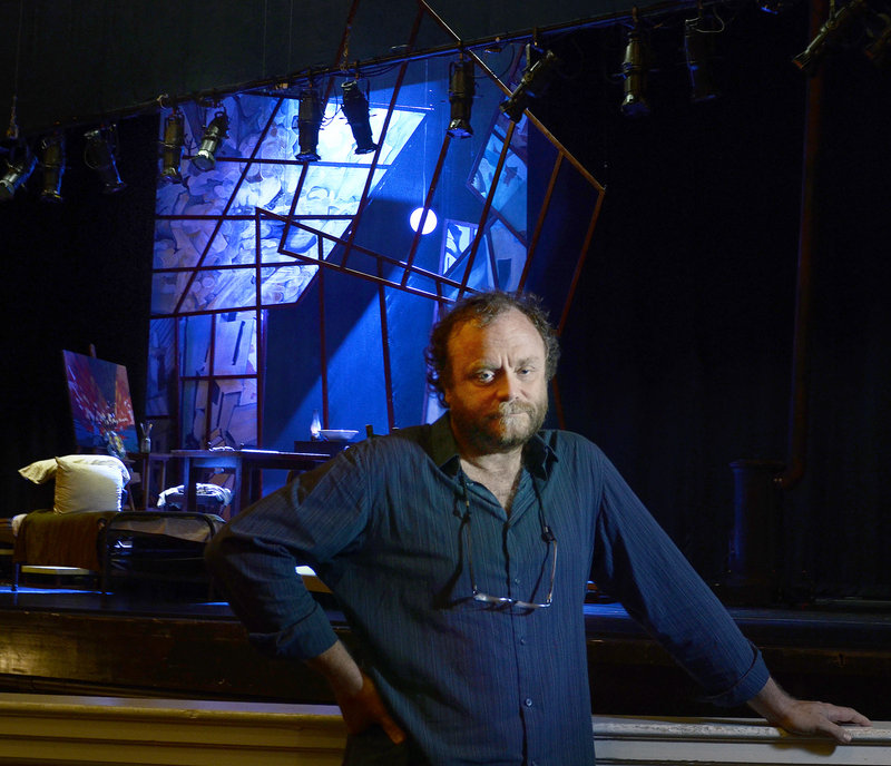 """Chris Akerlind, a Tony Award-winning lighting designer who lives in Portland, poses for a portrait in front of the stage of """"La Boheme"""" at Merrill Auditorium Monday, July 22, 2013. Akerlind designed the lighting for the show, the first time in near 20 years of living in Portland that he has worked in the city."""