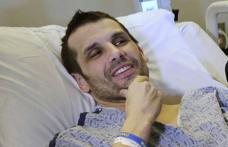 In this Thursday, May 9, 2013 photo, Marc Fucarile smiles while speaking with reporters, in Boston. Fucarile, who lost a leg during an explosion at the Boston Marathon, was released from the Spaulding Rehabilitation Hospital Wednesday July 24, 2013, exactly 100 days after the attack that killed three people and wounded more than 260. He is the last hospitalized victim of the Boston Marathon bombings to be discharged. (AP Photo/Steven Senne)