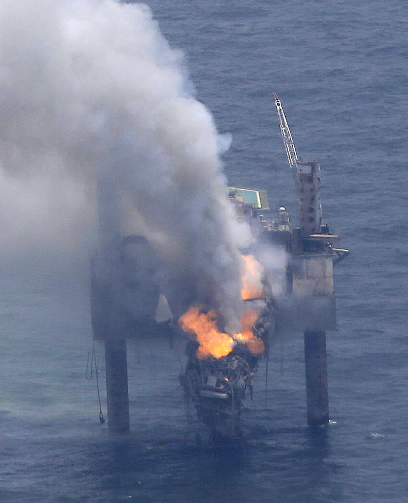 A fire blazes on the Hercules Offshore Inc. drilling rig off the coast of Louisiana on Wednesday. Natural gas spewed uncontrolled from the well Tuesday after a blowout that forced the evacuation of 44 workers.