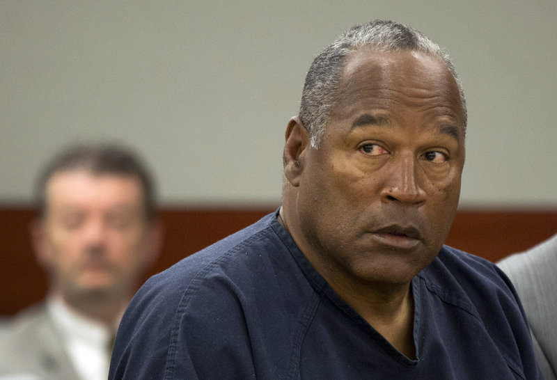 "O.J. Simpson told a parole panel Thursday that he's been a model inmate and that his crime was ""trying to retrieve for my family my own property."""