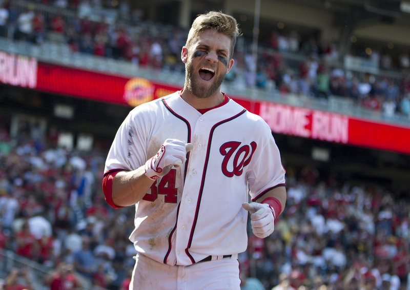 Washington's Bryce Harper celebrates his game-winning two-run homer against the Pittsburgh Pirates on Thursday. The ninth-inning shot gave the Nationals a 9-7 victory.