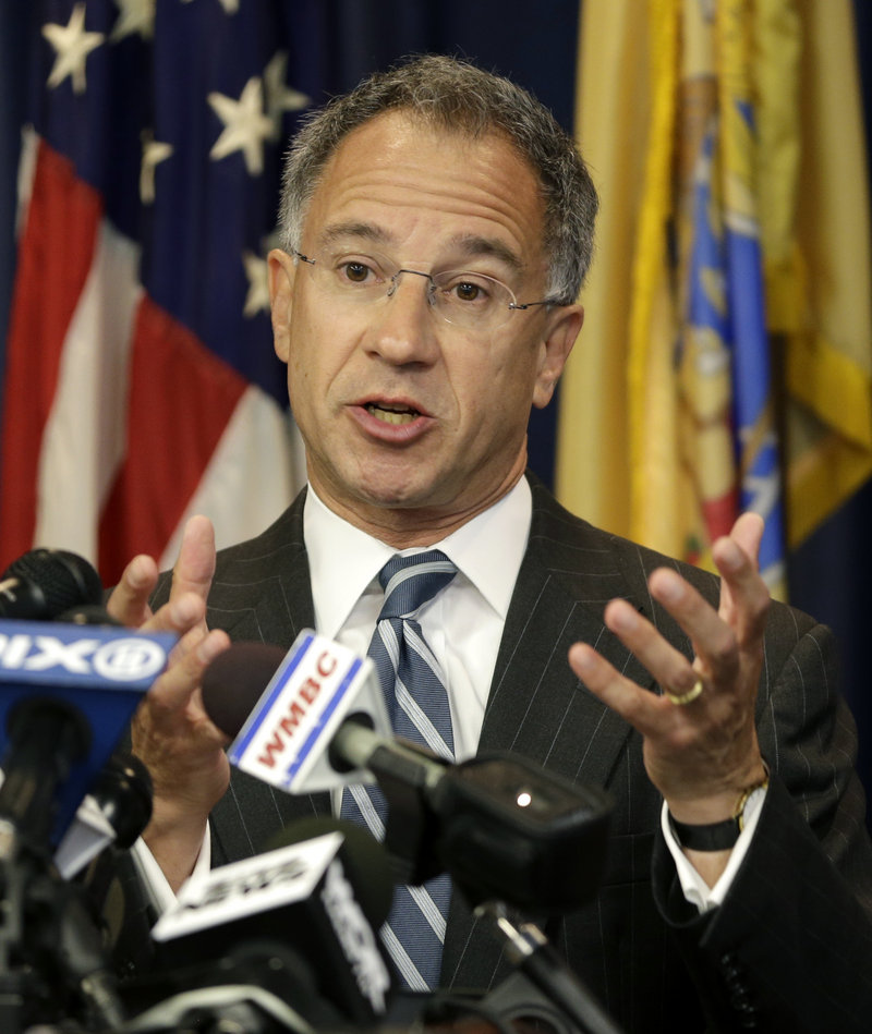 U.S. Attorney Paul Fishman talks about the arrest of four Russian nationals and a Ukrainian during a news conference Thursday in Newark, N.J.