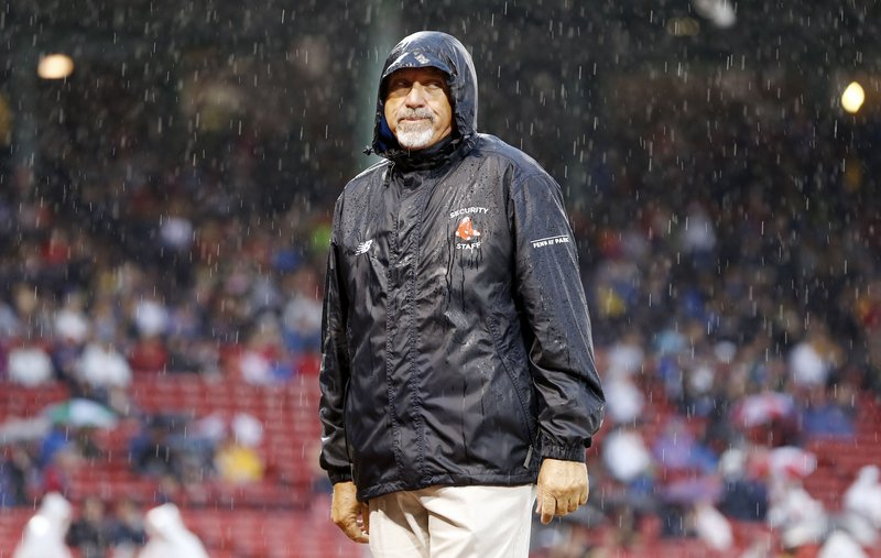 It was a wet night in Boston, as this Fenway Park security guard can attest. The game between the Red Sox and Rays was postponed to Monday.
