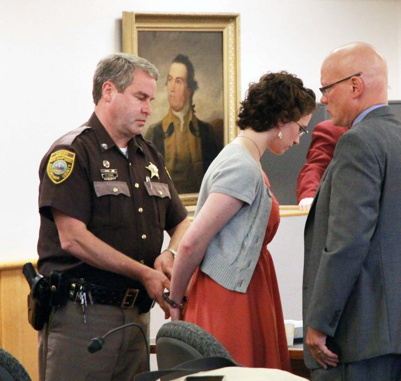 """Kathryn """"Kat"""" McDonough, 19, of Portsmouth, N.H., is led away after being sentenced at the Rockingham Superior Courthouse, Thursday, July 25, 2013 in Brentwood, N.H. McDonough, a New Hampshire woman charged with lying to investigators about the disappearance and death of a University of New Hampshire sophomore last fall has been sentenced to 1½ -3 years in prison. (AP Photo/The Herald, Rich Beauchesne)"""