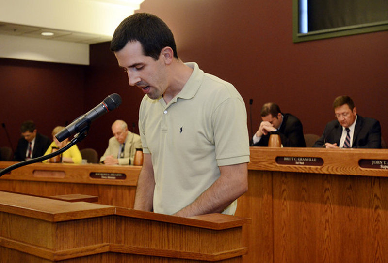 Nathan Miller leads a brief opening prayer at a town board meeting in Greece, N.Y., on June 16.